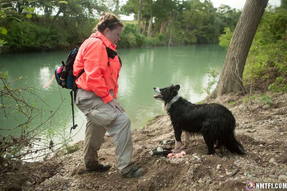 San Marcos, TX, August 22, 2015-- Volunteer TEXSAR Search & Rescue team member Tiffanie Turner and her search dog Rowan pause along the Blanco River after an extensive search for Wimberley residents that are still missing. Andrea Booher/FEMA