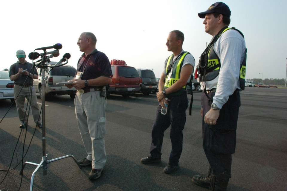 Gulfport, Miss., Sept. 9, 2005 -- FEMA Public Information Officer, Butch Decote introduces (l)Tim Sevison and (r) Dr. David Jaslow during a press conference. They are part of FEMA's Pennsylvania Urban Search and Rescue Team 1. FEMA/Leif Skoogfors