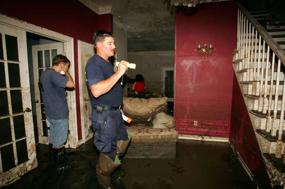Chalmette, La., Sept. 17, 2005 -- Jeff Barry of Los Angeles County Urban Search and Rescue helps two homeowners to safely inspect their home for damage from Hurricane Katrina. Bob McMillan/ FEMA Photo