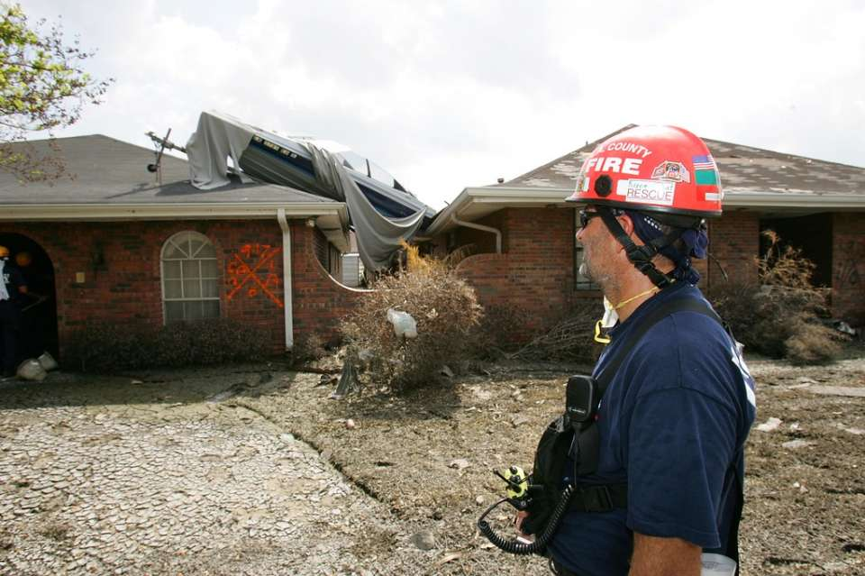 Chalmette, La., Sept. 17, 2005 -- John Haugh of Los Angeles County Fire Department's California Task Force 2 Urban Search and Rescue surveys the extensive damage from the storm surge from Hurricane Katrina. Bob McMillan/ FEMA Photo