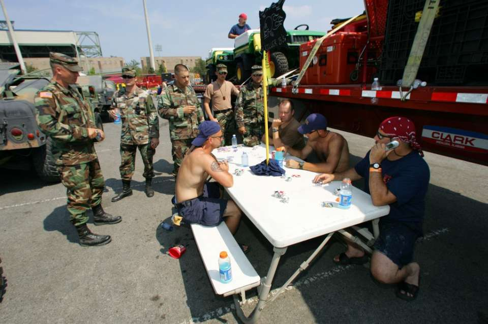New Orleans, La., Sept. 15, 2005 -- Members of California Task Force 3 Urban Search and Rescue unwind with a game of poker in between rescue missions. Bob McMillan/ FEMA Photo