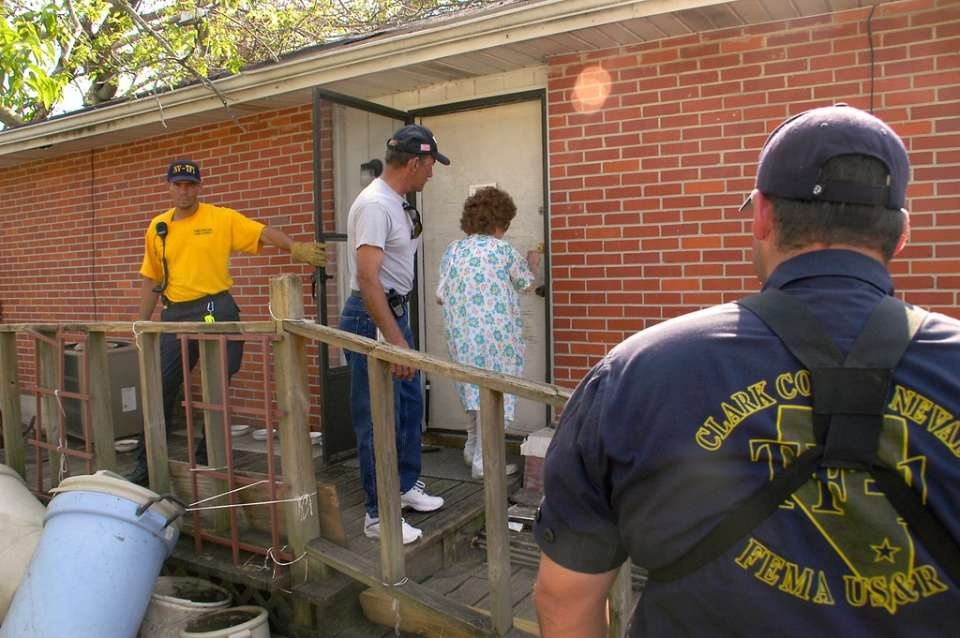 9-14-05 Mary, who is 81 years, is locking her door as she leaves her home. She had refused to leave her home and pets until her son, and FEMA Task Force 1 Urban Search & Rescue Team, came to help her. MARVIN NAUMAN/FEMA photo
