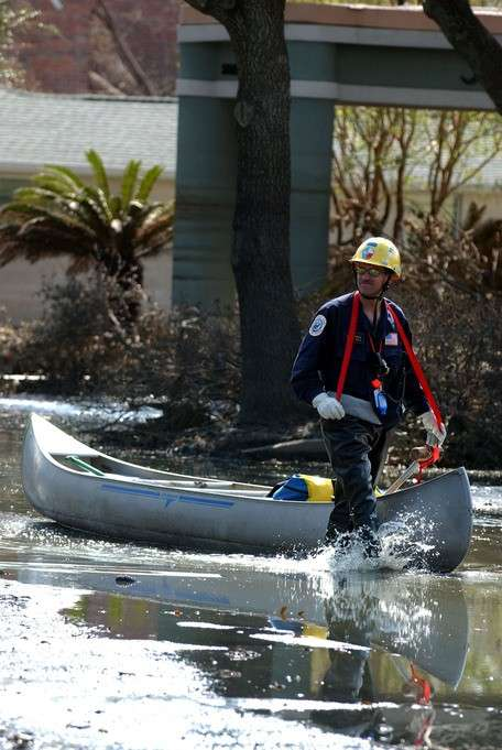 New Orleans, La., September 15, 2005 -- A member of the FEMA Urban Search and Rescue, Texas Task force 1 brings a canoe along to get to areas still in water as a result of Hurricane Katrina. Jocelyn Augustino/FEMA