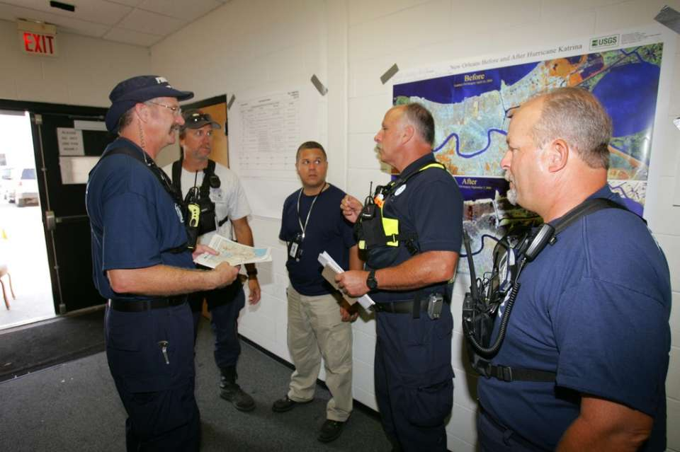 New Orleans, La., Sept. 14, 2005 -- Tim Gallagher of FEMA's Incident Support Team - Operations strategizes with fellow team members before another day of Urban Search and Rescue. Bob McMillan/ FEMA Photo