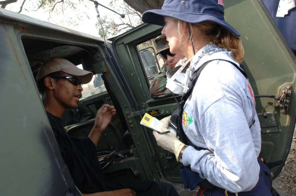 New Orleans, La., 9/18/05  - A member of the FEMA Urban Search and Rescue, Florida Task Force 1 (right) and a member of the Oregon National Guardsmen, check the vital signs of Reyne Johnson, a 39 year old man who was found alive. Jocelyn Augustino/FEMA